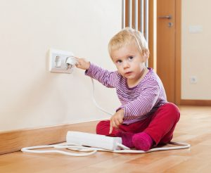 child playing with electric outlet